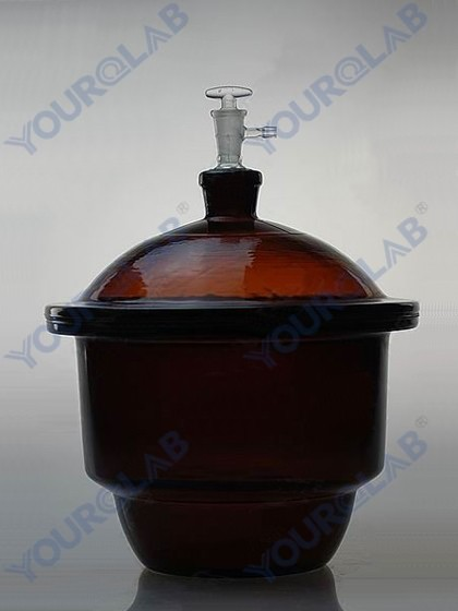 VACUUM DESICCATOR with ground-in stopcock and porcelain plate,amber glass